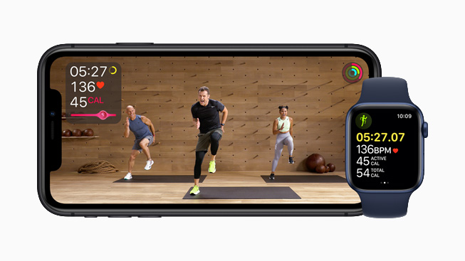 iPhone 11 Pro displaying a studio workout in Apple Fitness+.