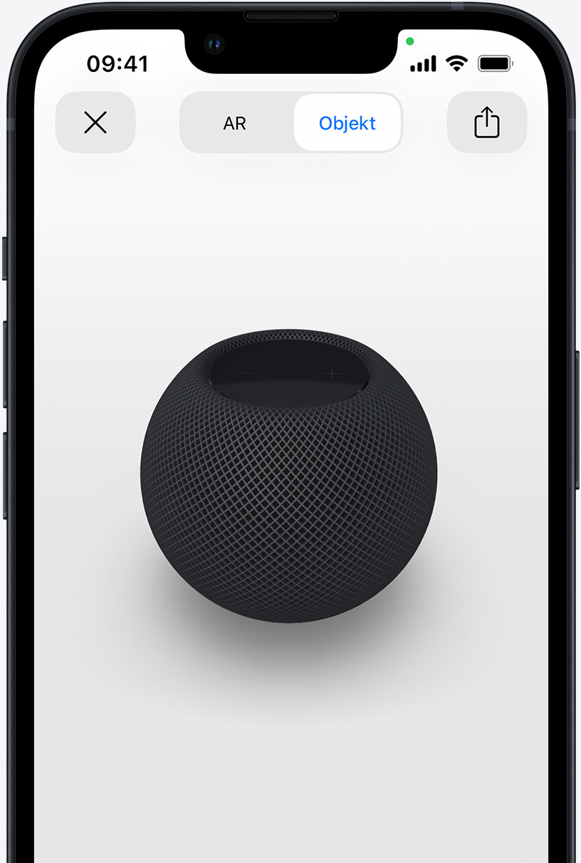 Der HomePod in Space Grau auf dem Display eines iPhone in AR Ansicht.