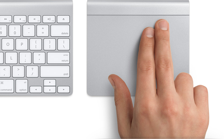 Two fingers about to swipe on the trackpad.