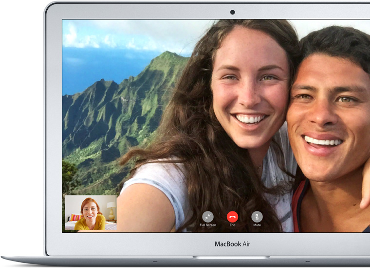 MacBook Air showing FaceTime call between a father and his girls.