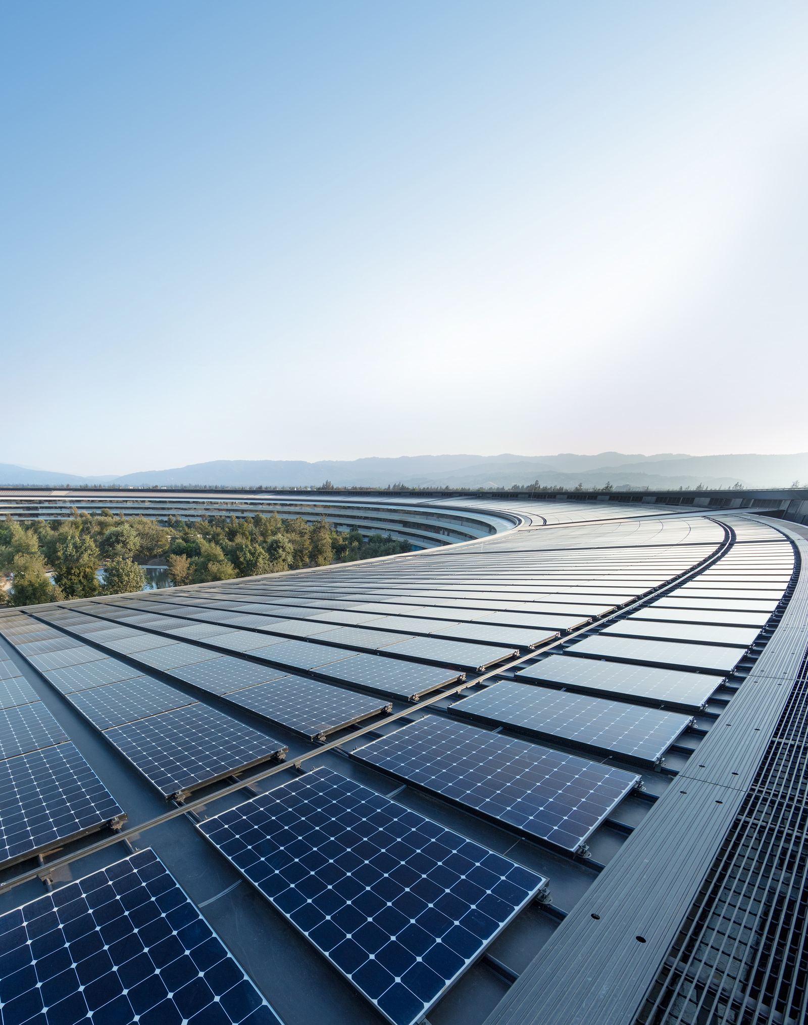 The rooftop solar installation at Apple Park helps power the building with 100 percent renewable energy