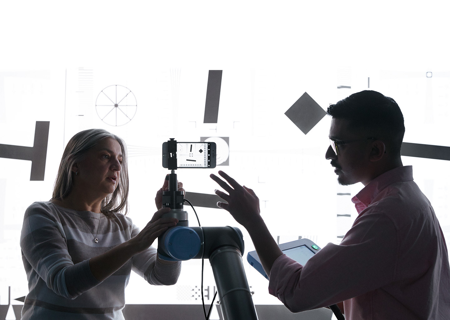 Two employees from the camera team collaborate in a lab