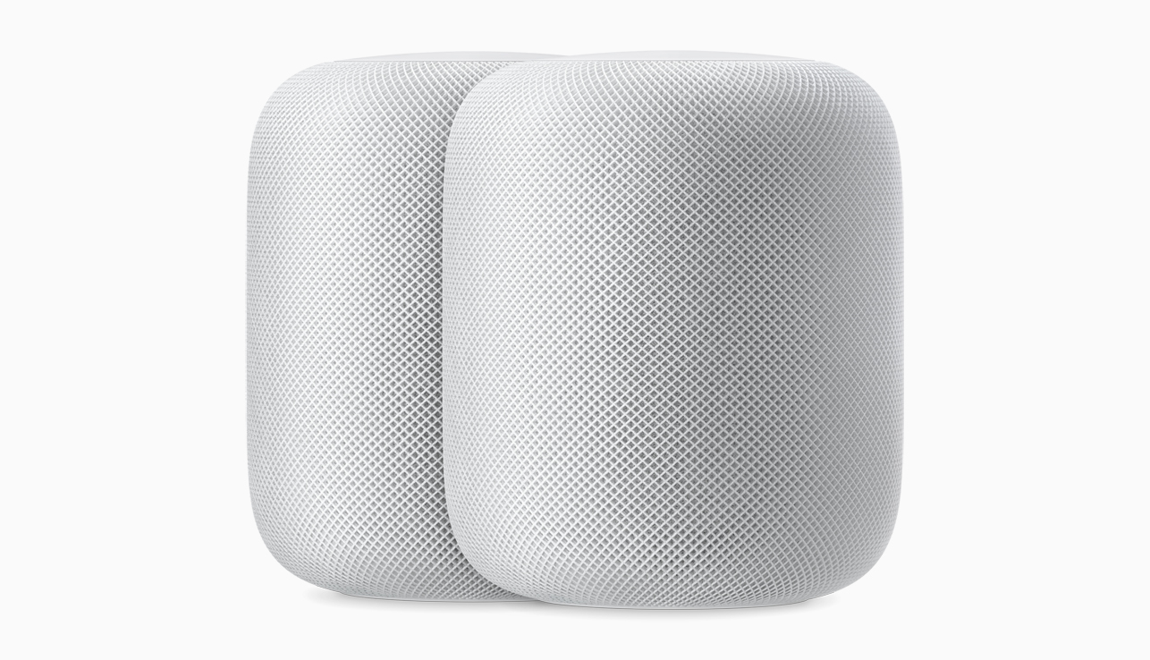 Two white HomePods.