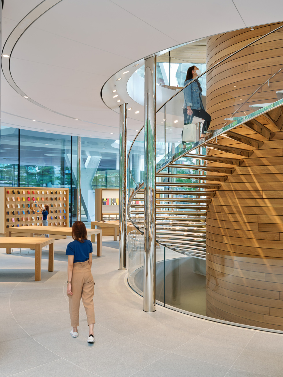 The spiral staircase and timber core at the center of Apple Central World.