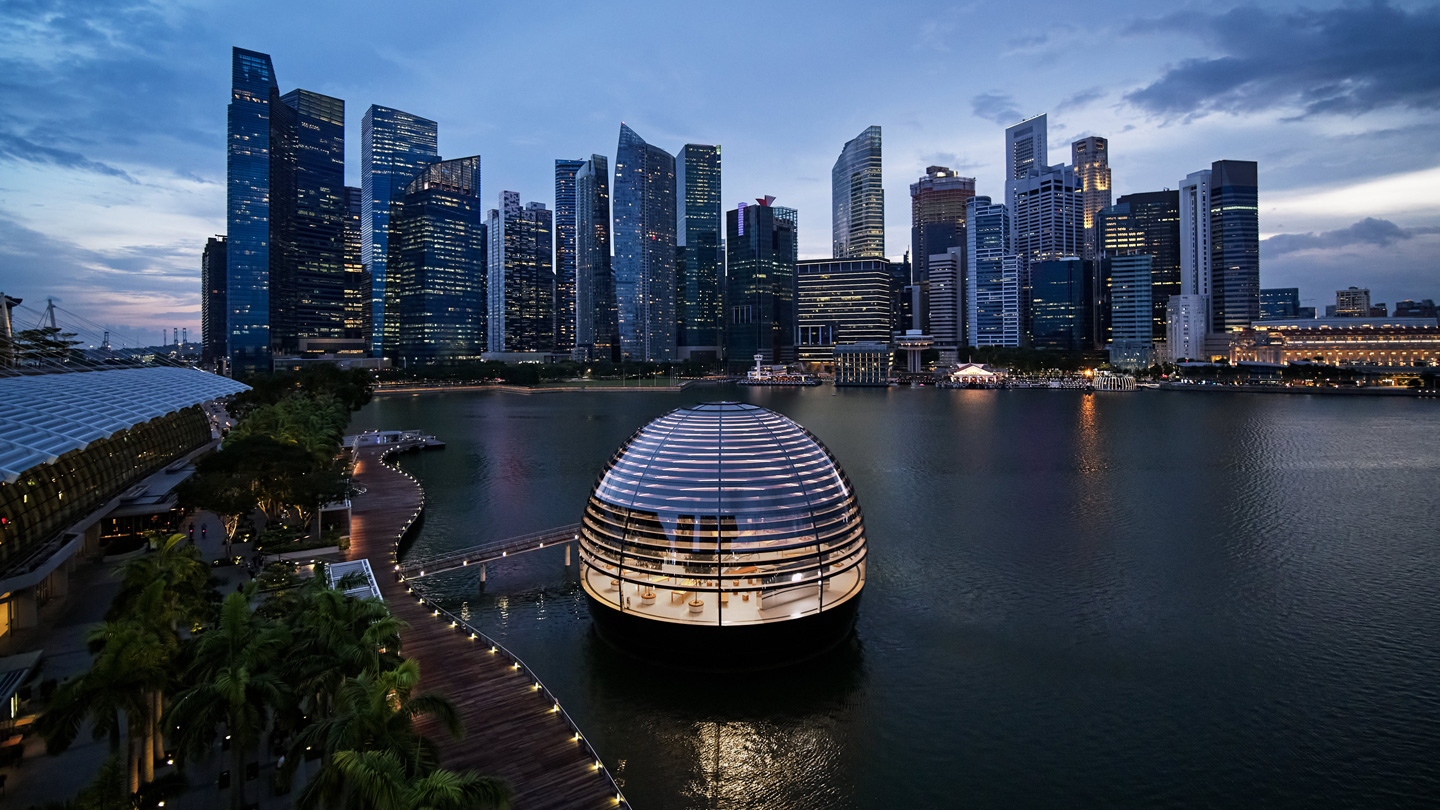 Exterior of Apple Marina Bay Sands dome with the city skyline.