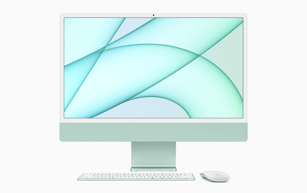 綠色 iMac 搭配同色系的巧控鍵盤和巧控滑鼠。