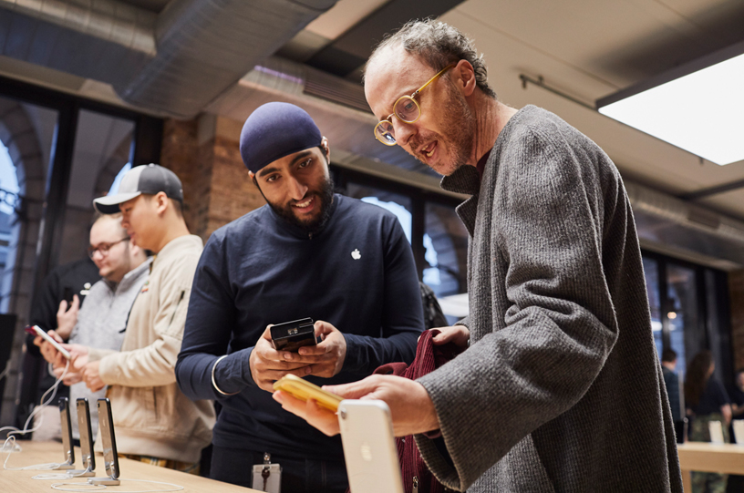 An Apple Covent Garden team member discussing the iPhone XR with a customer.