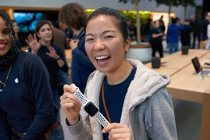 A woman holds up a new Apple Watch Series 4.