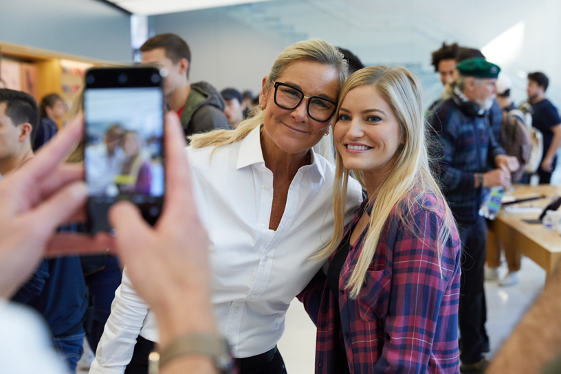 Angela Ahrendts poses for a photo with iJustine at Apple Union Square in San Francisco.