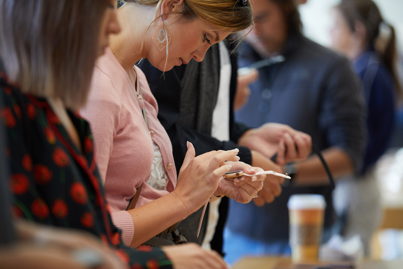 A woman looks at the new Apple Watch Series 4.