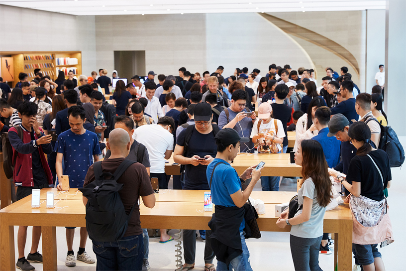 A crowd of people inside the Apple Orchard Road retail store.