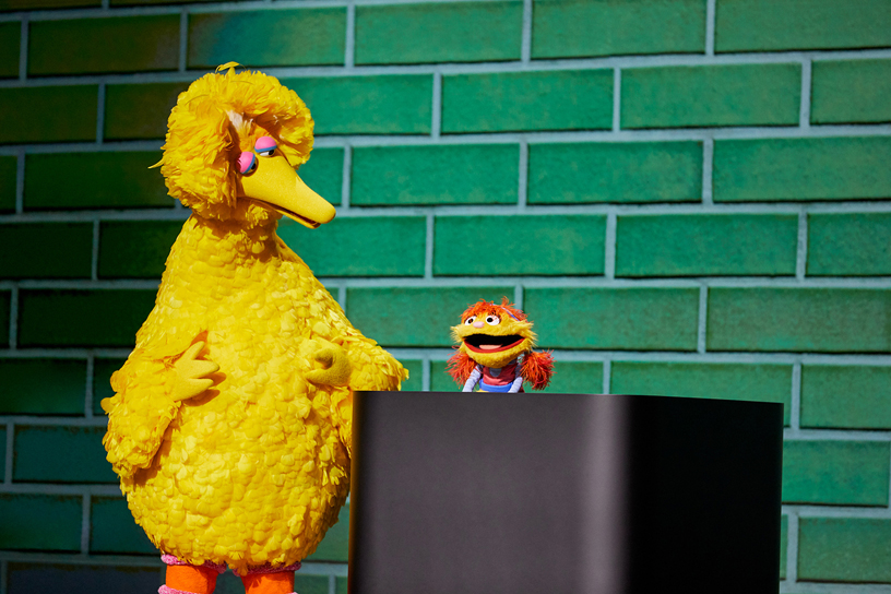 Big Bird and Cody from Sesame Street on stage at Steve Jobs Theater.