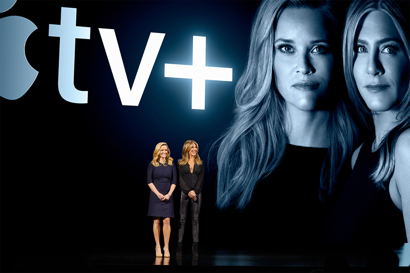 Reese Witherspoon and Jennifer Aniston on stage at Steve Jobs Theater.