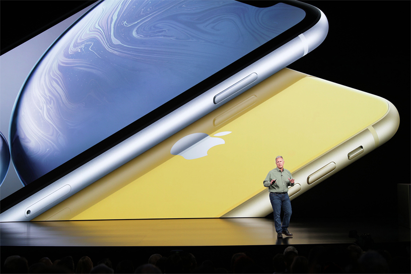 Phil Schiller in front of iPhone XR image on stage.
