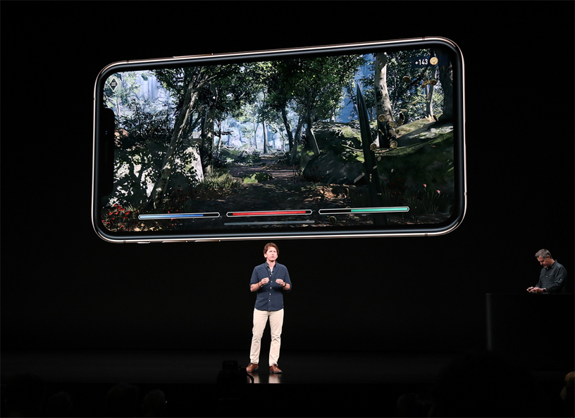 Todd Howard on stage presenting The Elder Scrolls: Blades game demo on iPhone Xs.