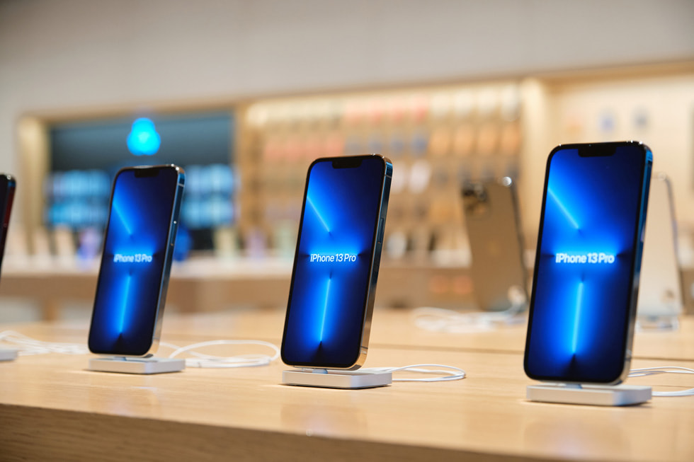 A close-up of a display table at Apple Sanlitun for iPhone 13 Pro.