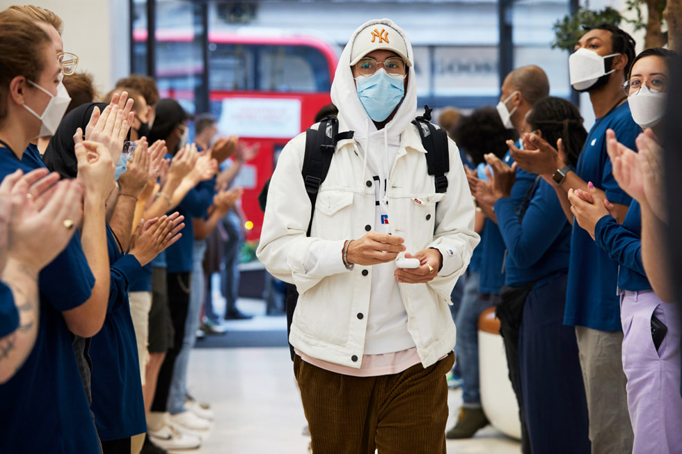Team members at Apple Regent Street greet customers arriving for the iPhone 13 lineup.