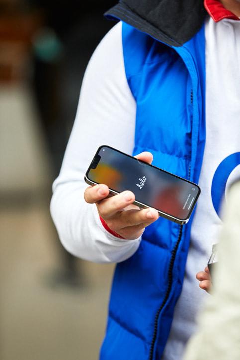An Apple Regent Street customer setting up his new iPhone 13.