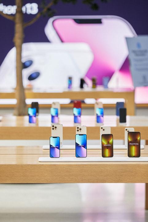 iPhone 13 models on display tables inside Apple Regent Street.