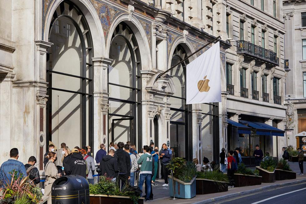 A line of customers outside of Apple Regent Street.
