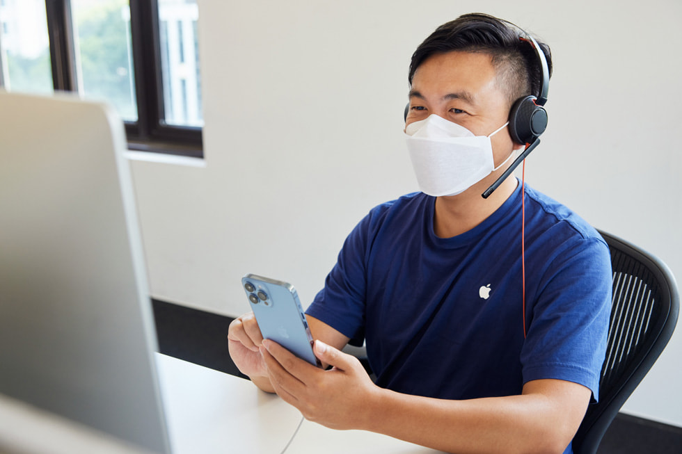 An Apple online team member at the call centre in Shanghai advises a customer on the new iPhone 13 Pro Max.