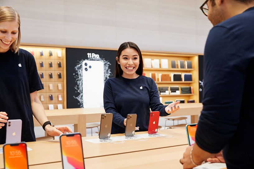 Apple team members stocking Apple Fifth Avenue with iPhone 11.