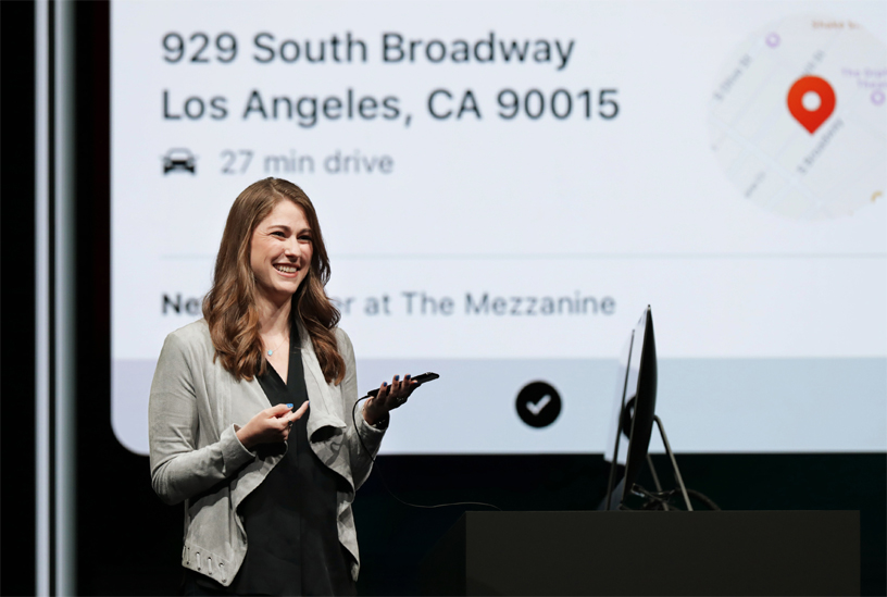 Kimberly Beverett demos Siri Shortcuts on stage at WWDC 2018.
