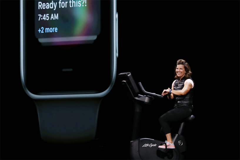Julz Arney demos watchOS on a stationary bike on stage at WWDC 2018.