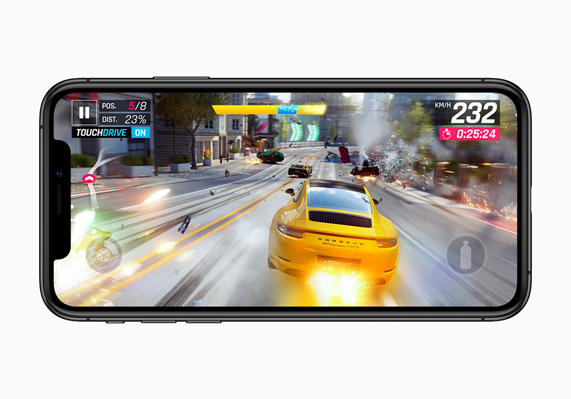 "Car racing gameplay from ""Asphalt 9: Legends"" displayed on iPhone XS."