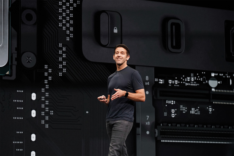 John Ternus on stage at WWDC 2019.