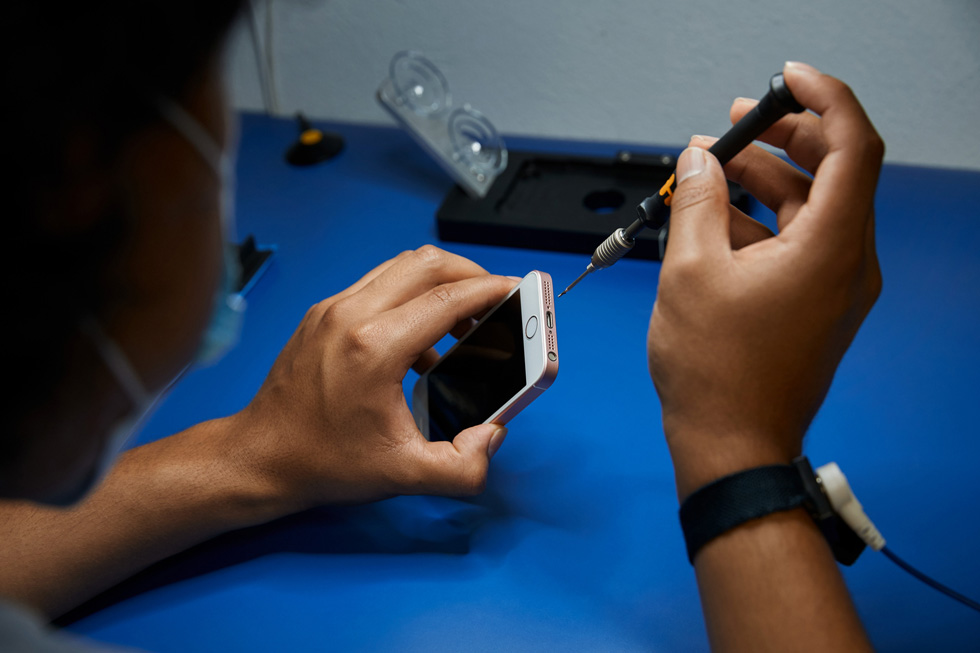 A technician repairing an iPhone.