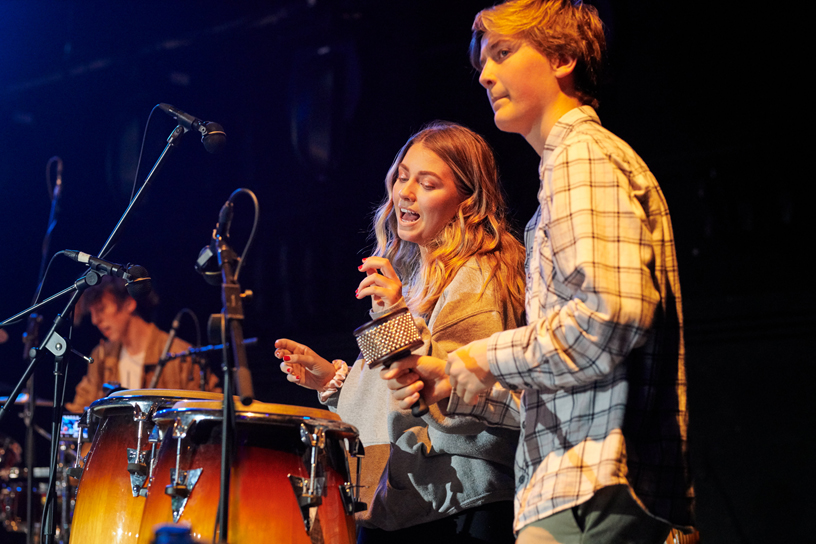 Two students playing percussion.