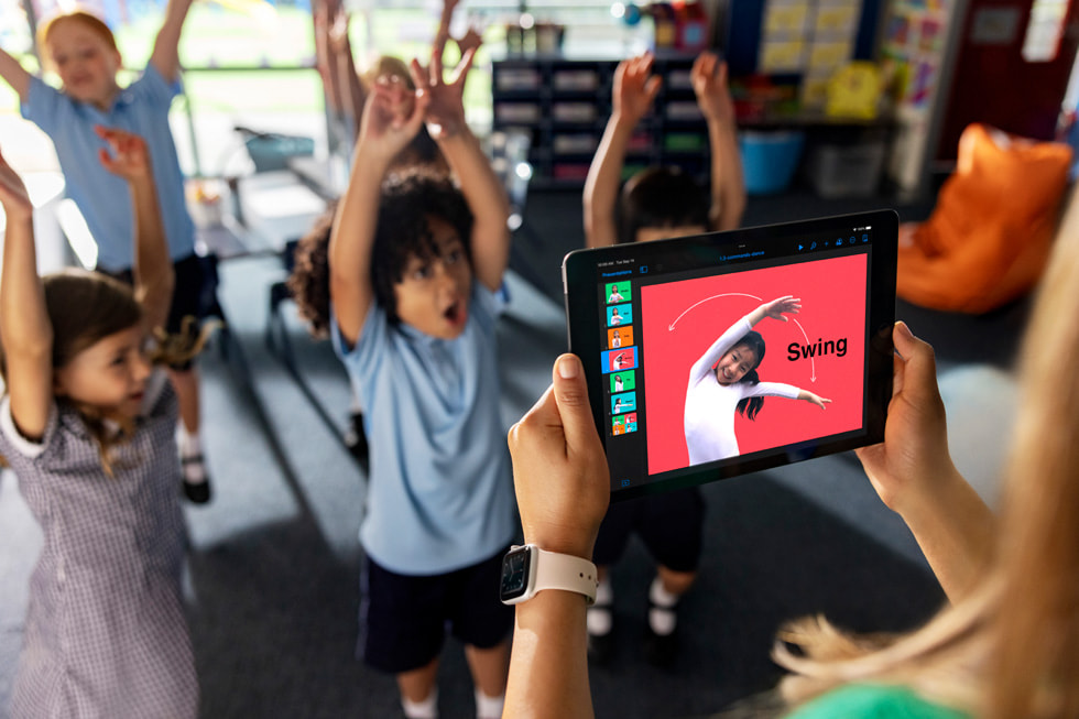 Students participate in a lesson on coding commands taught through dance moves in a classroom setting.