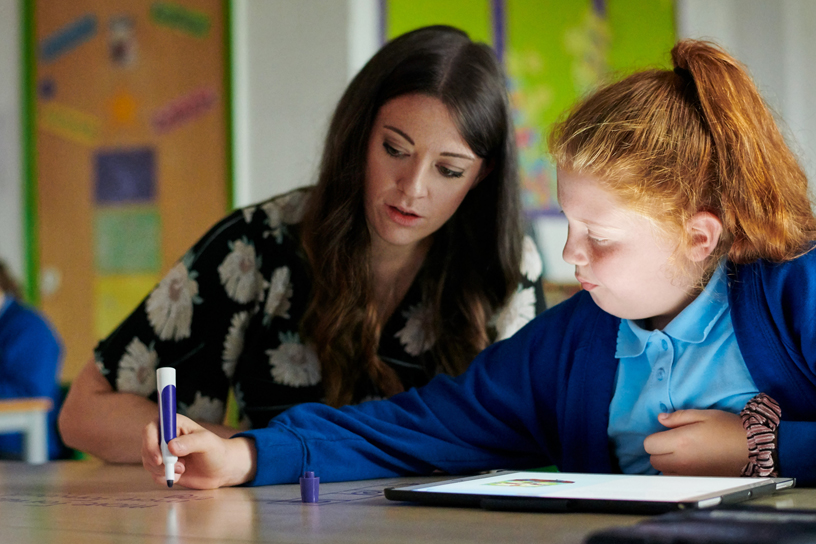 Teacher Alice Nutt with a student at Layton Primary School in Blackpool, England.