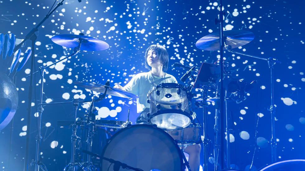 Drummer Shi Lu playing on stage.