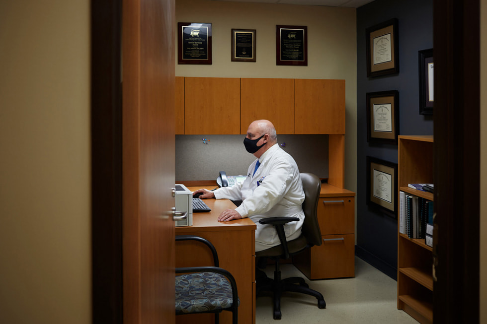 Dr. Tony Alleman of Regional One Health's Wound Care Center working in his office.