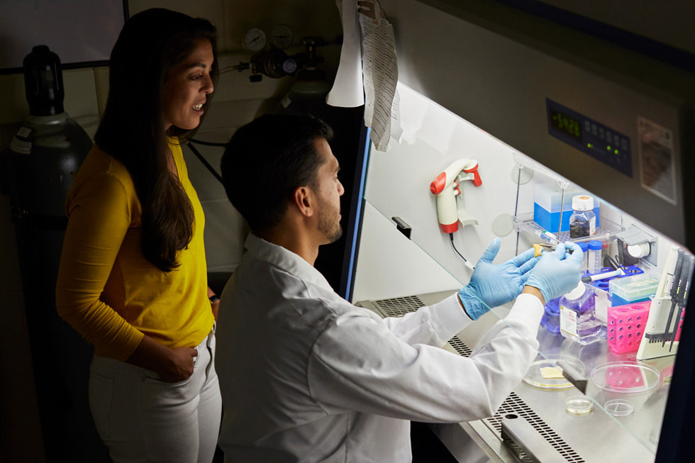 Kayla Rodriguez Graff and Isaac Rodriguez, co-founders of SweetBio, working in a lab.