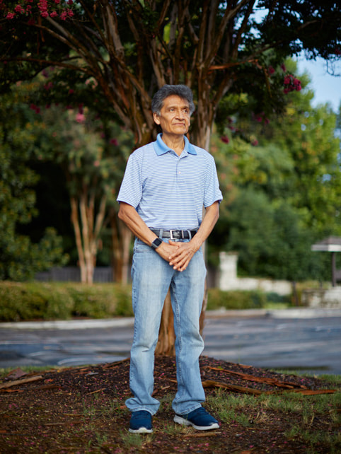 Regional One Health patient Lauro Salvador standing in front of a tree.