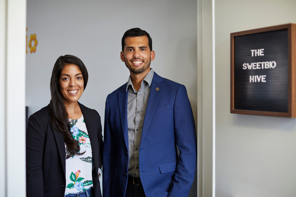 Kayla Rodriguez Graff and Isaac Rodriguez, co-founders of SweetBio, posing in front of their office.
