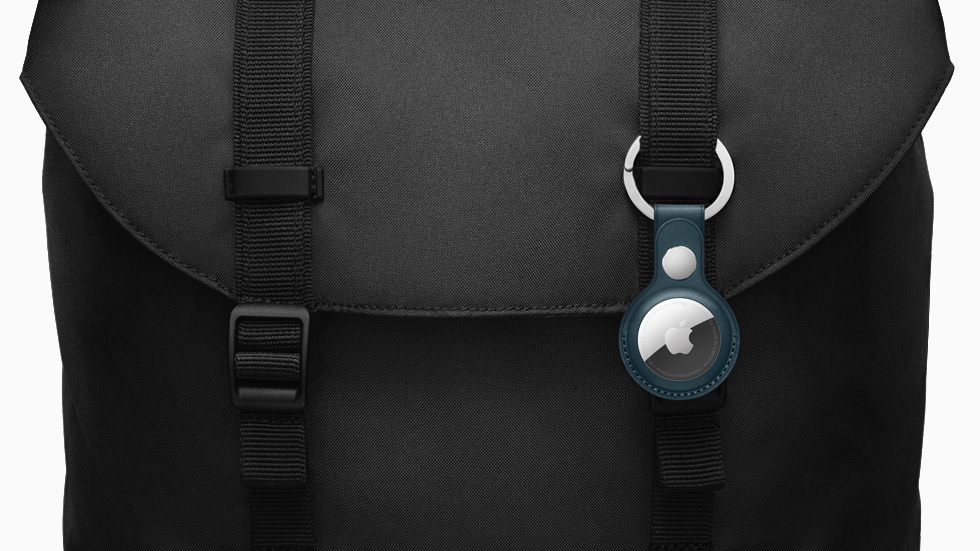 AirTag accessorized with the Leather Key Ring, attached to a messenger bag.