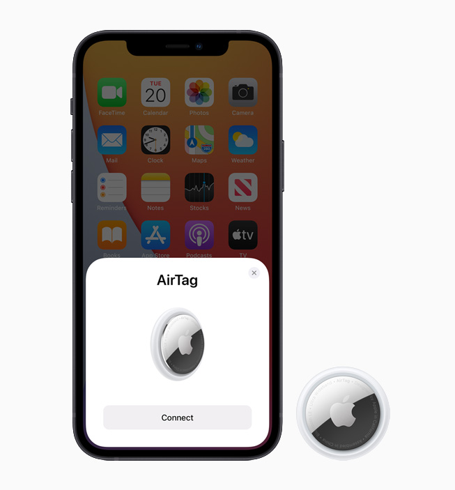 iPhone 12 displaying AirTag setup screen, alongside AirTag device.