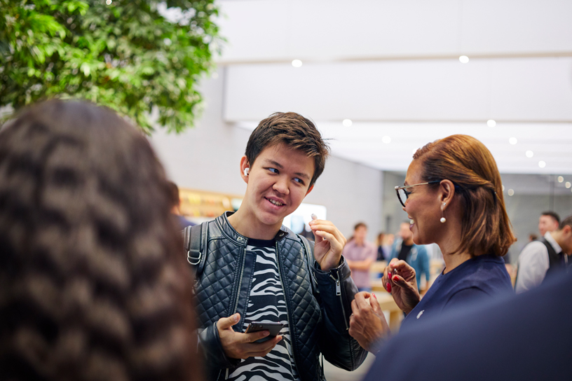 Customers try on AirPods Pro at Apple Piazza Liberty in Milan.
