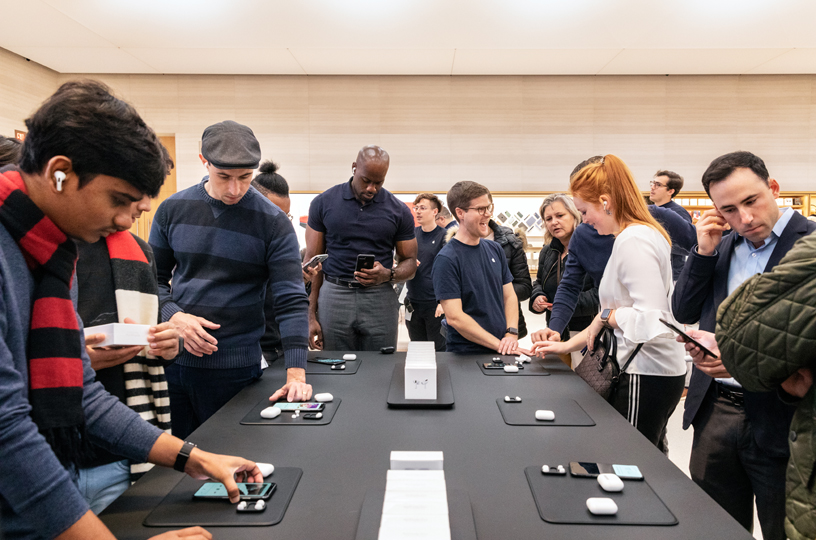 Customers surround the AirPods Pro table at Apple Fifth Avenue in New York.