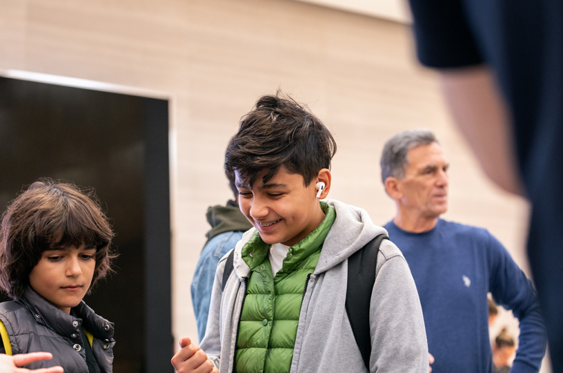 Young customers test out AirPods Pro.