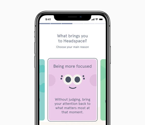 iPhone X showing Headspace App on screen.