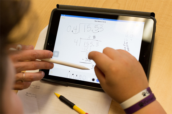 Apple Pencil being used to do long division on an iPad.
