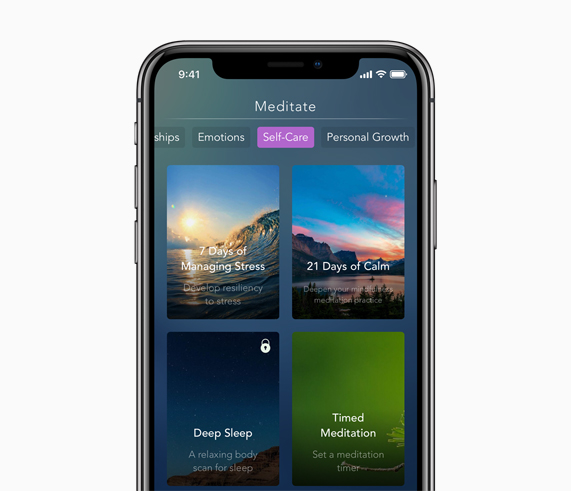 iPhone with Calm meditation app on screen.