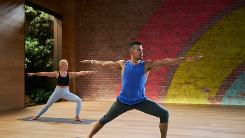 Yoga workout in the Apple Fitness+ studio.