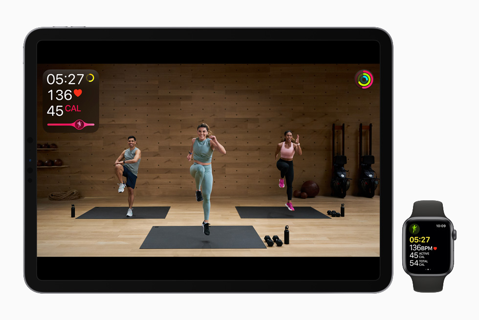 Anja Garcia leads an HIIT workout, displayed on iPad Pro and Apple Watch Series 6.