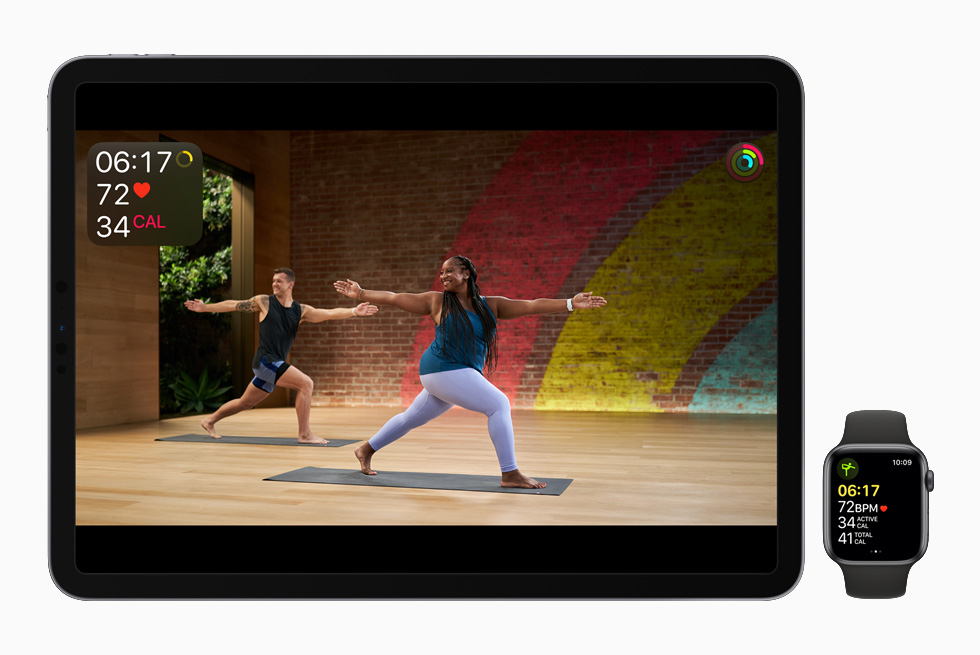 Jonelle Lewis leads a Yoga workout, displayed on iPad Pro and Apple Watch Series 6.